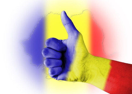 Thumb up with digitally body-painted Romania flag photo