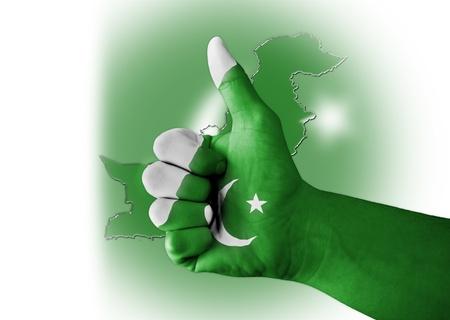 pakistan: Thumb up with digitally body-painted Pakistan flag Stock Photo
