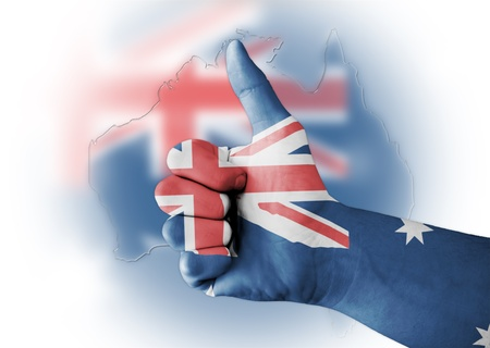 Thumb up with digitally body-painted Australia flag photo