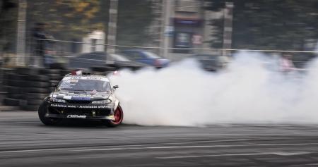 nissan: Romania, Bucharest - October 21,2011: Drifting car at the Grand Prix of Romania