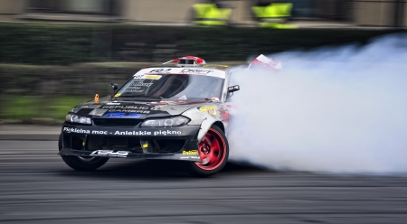 drift: Romania, Bucharest - October 21,2011: Drifting car at the Grand Prix of Romania