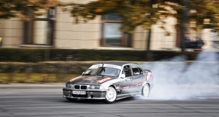 thrill: Romania, Bucharest - October 21,2011: Drifting car at the Grand Prix of Romania