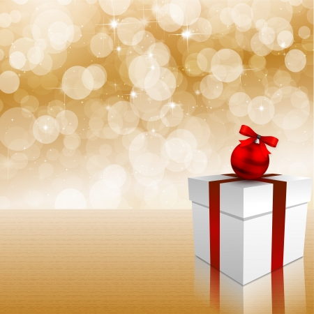 silvester: Christmas gift box and bauble on background of defocused golden lights
