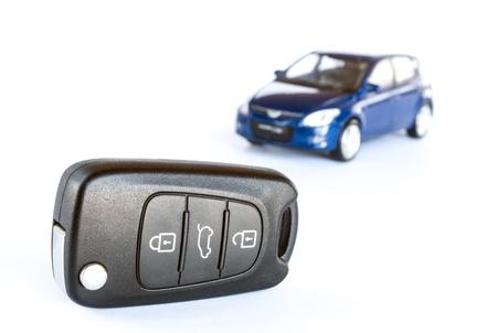 Key   blue car isolated on the white background Stock Photo - 17853455