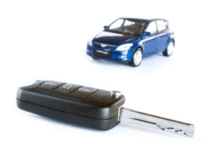 Key   blue car isolated on the white background photo