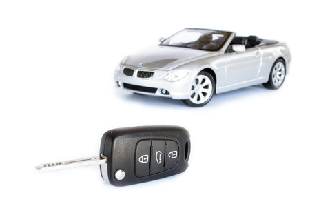 Key   silver car isolated on the white background photo