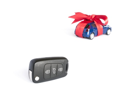 Gift car concept with red Bow and car key on focus photo