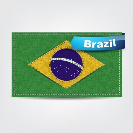 brazilian flag: Fabric texture of the flag of Brazil with a blue bow.