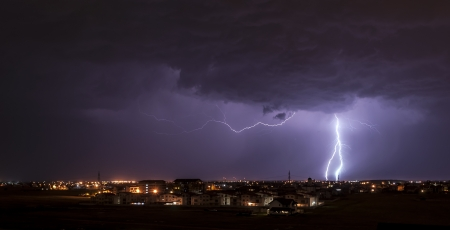 Lightning over small town photo