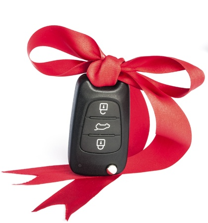 car showroom: Gift key concept with red Bow on a white background  Stock Photo