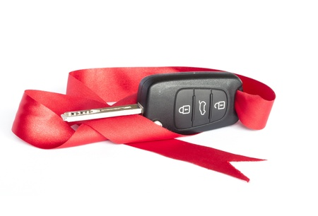 Gift key concept with red Bow on a white background  photo
