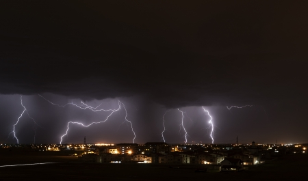electrical energy: Severe lightning storm over a small city