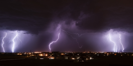 rainstorm: Severe lightning storm over a small city