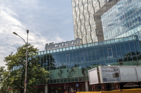 microsoft: BUCHAREST, ROMANIA - JUNE 21: Microsoft Building on JUNE 21, 2013 in Bucharest, Romania. Microsoft is an American software corporation headquartered in Redmond and founded by Bill Gates in 1975.