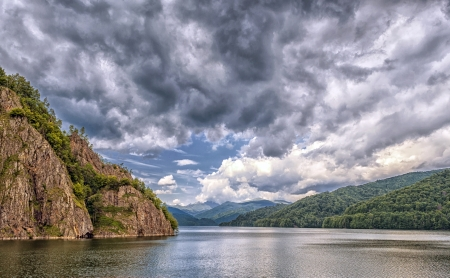 Landscape with Vidraru dam Lake in Fagaras mountains in Romania photo