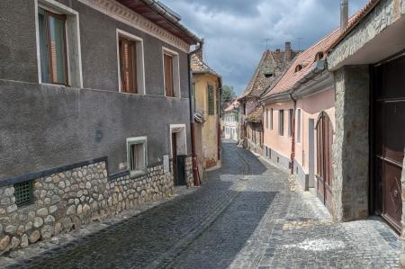 urbanized: Sibiu, town in Transylvania, Romania. Old street of residential buildings.