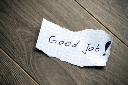 note of exclamation: Good Job - Hand writing text on wood background Stock Photo