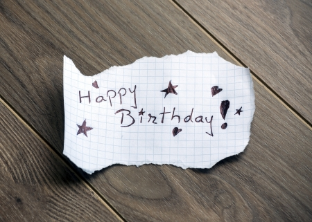 Happy Birthday - Hand writing text on wood background photo