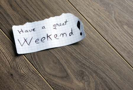 Have a great Weekend - Hand writing text on a piece of paper on wood background with space for text photo