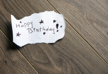 Happy Birthday - Hand writing text on wood background with space for text photo