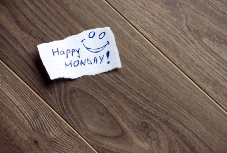 Happy Monday written on piece of paper, on a wood background. Space for your text. photo