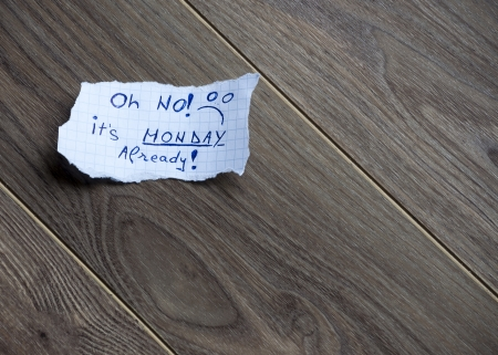 Monday message,written on piece of paper, on a wood background. Space for your text. photo