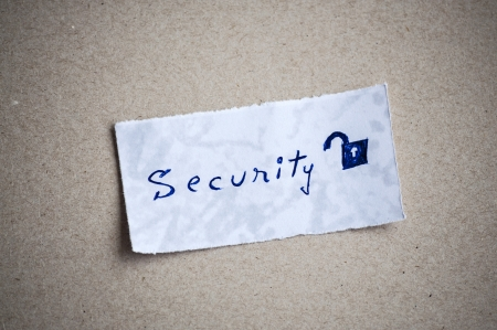 Security message,written on piece of paper, on cardboard background. Stock Photo - 21949934