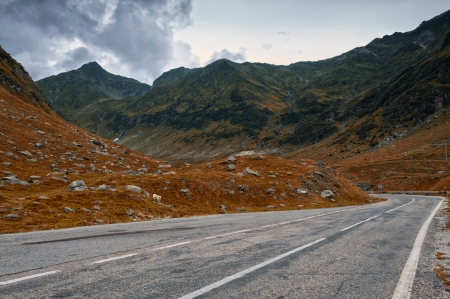 Grunge mountain road in autumn colors, Transfagarasan - Arges, Romania photo