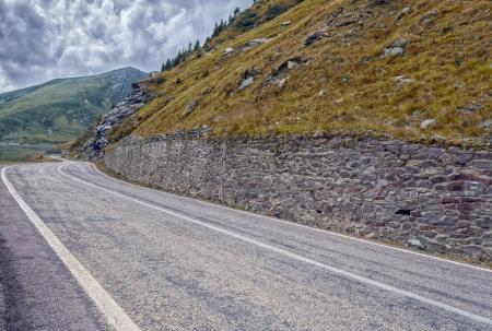 transfagarasan: Autumn mountain road on the Transfagarasan, Romania Fagaras Mountains Stock Photo