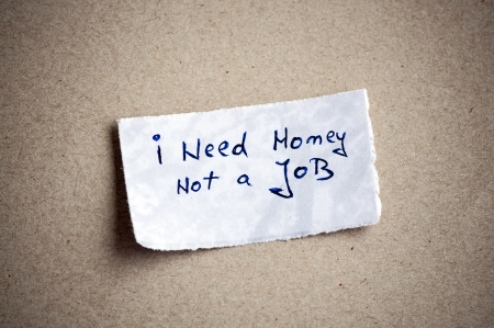 I need money, not a job message,written on piece of paper, on cardboard background. Space for your text. Stock Photo - 22000329