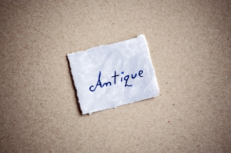 Antique message,written on piece of paper, on cardboard background. Space for your text. photo