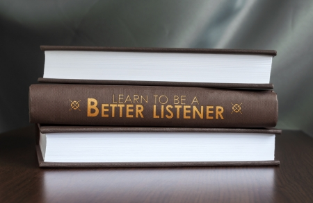 better: Books on a table and one with  Learn to be a better listener.  cover. Book concept.