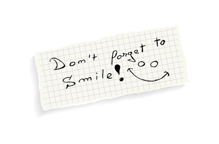 forget: Dont forget to smile! Hand writing text on a piece of math paper isolated on a white background.