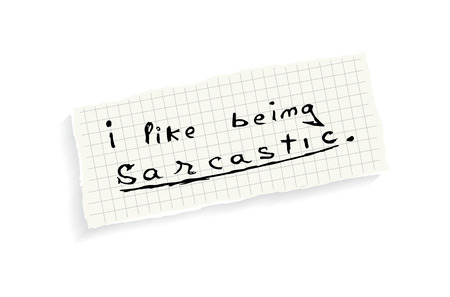 sarcastic: I like being sarcastic. Hand writing text on a piece of math paper isolated on a white background.