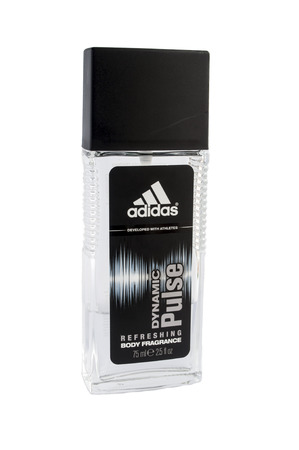adidas: Bucharest, Romania - January 24th: A bottle of Adidas body spray Isolated On White Background. Adidas dynamic pulse was launched in 1997 by the design house of adidas . It is a refreshing scent that is recommended for daytime wear.  Editorial