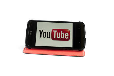 Bucharest, Romania - Jan 24, 2014: Photo of YouTube on smartphone screen. YouTube is a video-sharing website, created by three former PayPal employees in February 2005 and owned by Google since late 2006, on which users can upload, view and share videos,  Stock Photo - 25343194