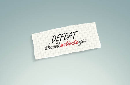 should: Defeat should motivate you. Hand writing text on a piece of math paper on a blue background.
