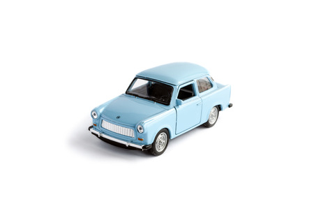 Bucharest, Romania - Jan 24, 2014: Photo of a toy Trabant isolated on white. The Trabant is a car that was produced by former East German auto maker VEB Sachsenring Automobilwerke Zwickau in Zwickau, Saxony