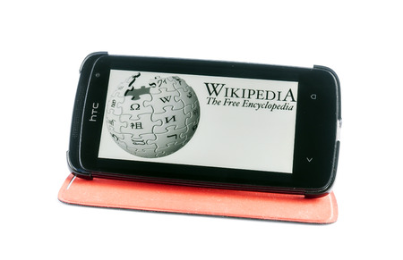 Bucharest, Romania - Jan 24, 2014: Photo of Wikipedia on smartphone screen. Wikipedia is a collaboratively edited, multilingual, free Internet encyclopedia that is supported by the non-profit Wikimedia Foundation
