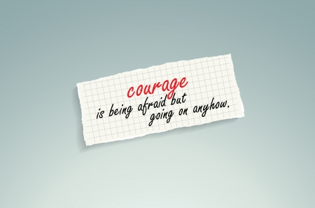 realize: Courage is being afraid but going on anyhow! Hand writing text on a piece of math paper on a blue background.