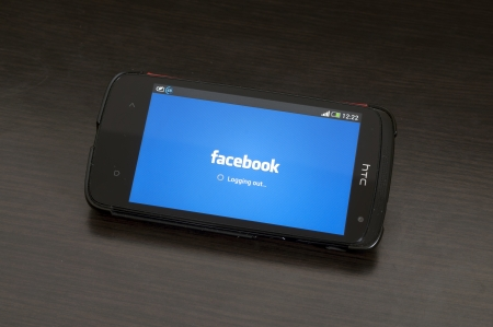 sourcing: Bucharest, Romania - January 28, 2014: Photo of a HTC Desire device, showing the Logging out from the Facebook app for Android devices.