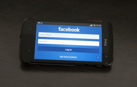Bucharest, Romania - January 28, 2014: Photo of a HTC Desire device, showing the Facebook homepage of the Android app featuring the Log In formular.