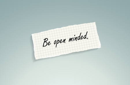 open minded: Be open minded. Hand writing text on a piece of math paper on a blue .