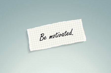 motivated: Be motivated. Hand writing text on a piece of math paper on a blue background. Illustration