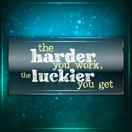 work piece: The harder you work, the luckier you get. Futuristic motivational background. Chalk text written on a piece of glass.
