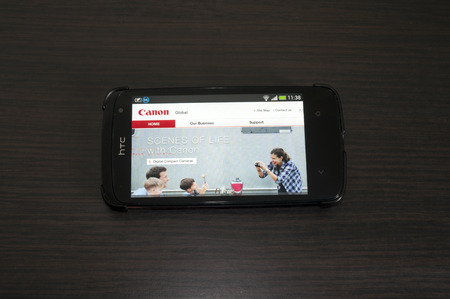 Bucharest, Romania - February 05, 2014: Photo of a HTC Desire device, showing the Canon web page.Canon Inc. is a Japanese multinational corporation specialized in the manufacture of imaging and optical products.