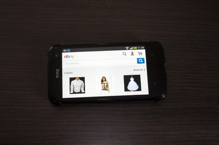 htc: Bucharest, Romania - February 05, 2014: Photo of a HTC Desire device, showing the EBAY webpage. eBay Inc. is an American multinational internet consumer-to-consumer corporation, headquartered in San Jose, California.