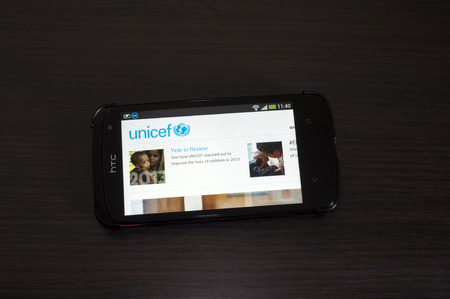 htc: Bucharest, Romania - February 05, 2014: Photo of a HTC Desire device, showing the UNICEF web page.The UNICEF is a United Nations Program, that provides long-term humanitarian and developmental assistance to children and mothers in developing countries.