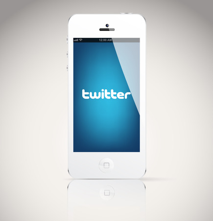 microblogging: Bucharest, Romania - February 06, 2014: Iphone 5 device, showing the Twitter logo. Twitter is an online social networking and microblogging service that enables users to send and read tweets