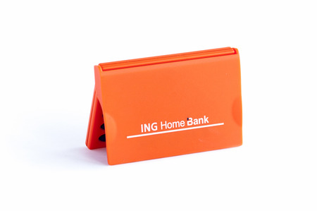 ing: BUCHAREST, ROMANIA - FEB 17,2014: ING Home Bank token isolated on white. The ING Group is a Dutch multinational banking and financial services corporation headquartered in Amsterdam.